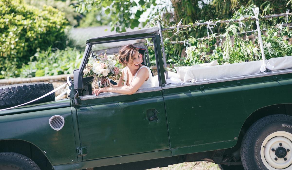 Bride in a landrover - Dorset weddings British Flowers