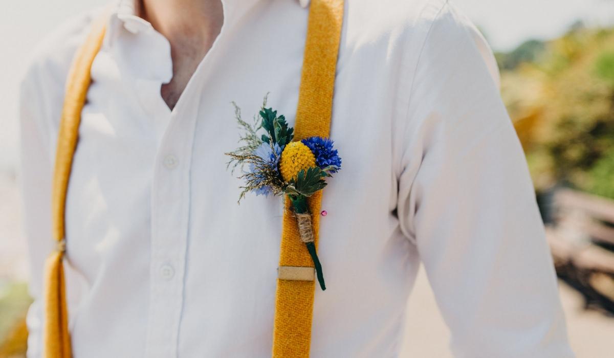 buttonhole and yellow braces - Dorset weddings British Flowers